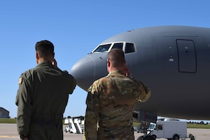 Col. Thad Middleton, 22nd Operations Group commander, and Col. Mark Baran, 22nd Air Refueling Wing vice commander, salute as the 13th KC-46A Pegasus arrives Oct. 11, 2019, at McConnell Air Force Base, Kan. The delivery was one of three aircraft to arrive on the installation. (U.S. Air Force photo by Airman 1st Class Marc A. Garcia)