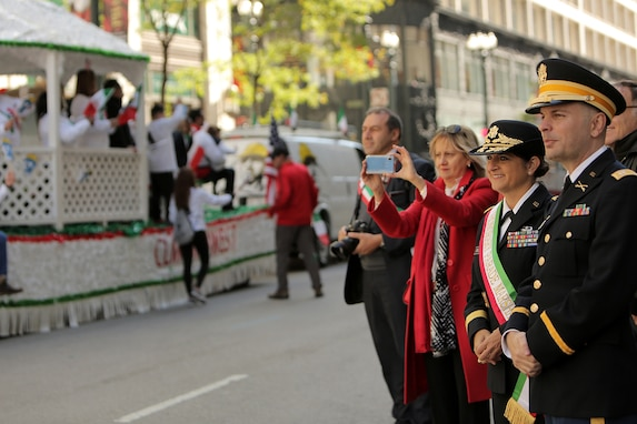 Brig. Gen. Kris A. Belanger, left, Commanding General, 85th U.S. Army Reserve Support Command, and Capt. Michael J. Ariola, Public Affairs Officer, 85th USARSC, both of Italian American heritage, watch a portion of the 67th Annual Columbus Day Parade in the City of Chicago, October 14, 2019.