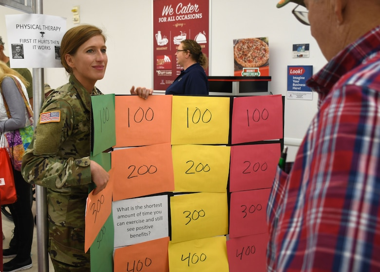 Physical therapist, Capt. Veronica Lazar, plays a physical therapy question and answer game with an attendee of the annual Fort Drum Retiree Application Day at the Fort Drum Exchange Sept. 21.