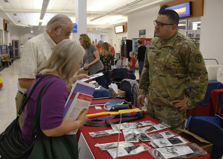 Staff Sgt. Osuna Castro discusses adaptive equipment and intervention techniques designed to increase functional independence with attendees of the annual Fort Drum Retiree Application Day Sept. 21.