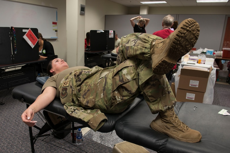Master Sgt. Jessica Roy of the 103rd Airlift Wing, Connecticut Air National Guard, prepares to donate blood, September 26, 2019 at Bradley Air National Guard Base, East Granby, Conn. Members of the 103rd donated 44 pints of blood during the drive. (U.S. Air National Guard photo by Tech. Sgt. Tamara R. Dabney)