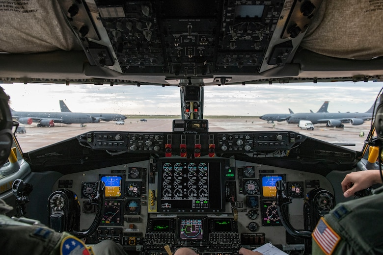 U.S. Air Force Capt. Ethan Cross (left), and U.S. Air Force Capt. Nick Flaute, KC-135 Stratotanker pilots assigned to the 54th Air Refueling Squadron, taxi out to the runway during an air defense exercise, October 9, 2019, at Altus Air Force Base, Okla.