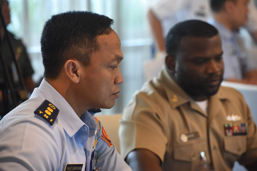 Indonesian officer and U.S. Navy chief petty officer participate in a cyber exercise.