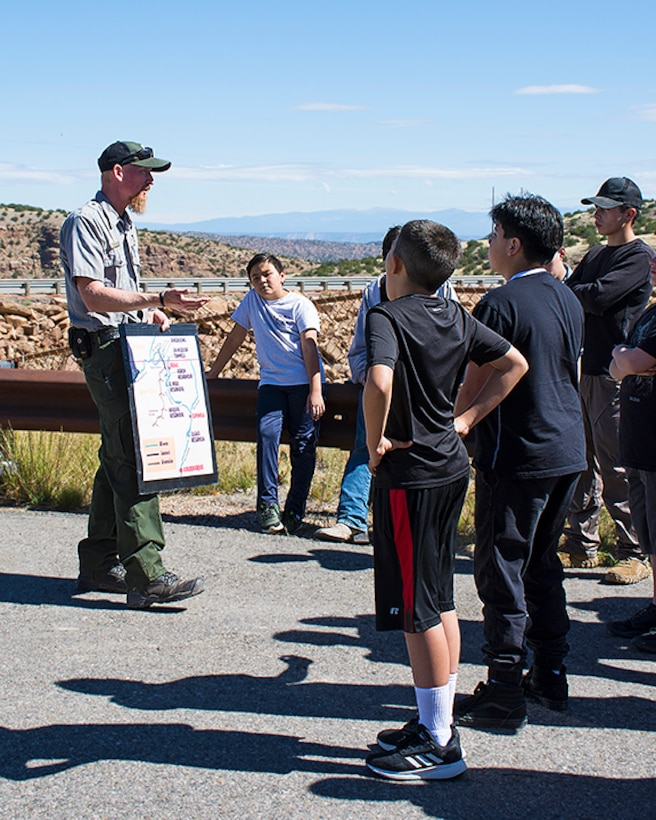 USACE-Albuquerque District park ranger Austin Kuhlman, far left, explains where the water in Abiquiu Lake comes from to students from Coronado High School and Middle School during their tour of Abiquiu Dam, Oct. 3, 2019.
