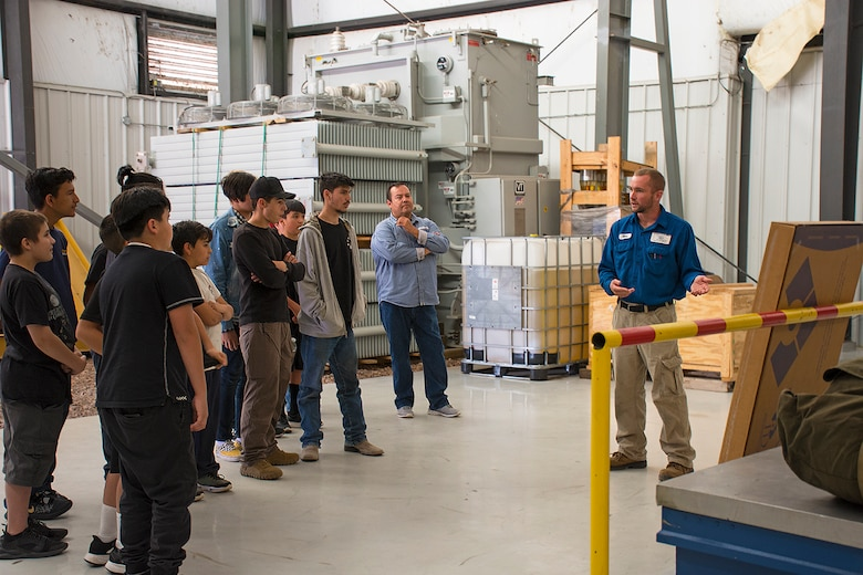 Matthew Weinman, with the Los Alamos Los Alamos Department of Public Utilities, (far right), gives an overview of the hydroelectric facility to students from Coronado High School and Middle School, Oct. 3, 2019.