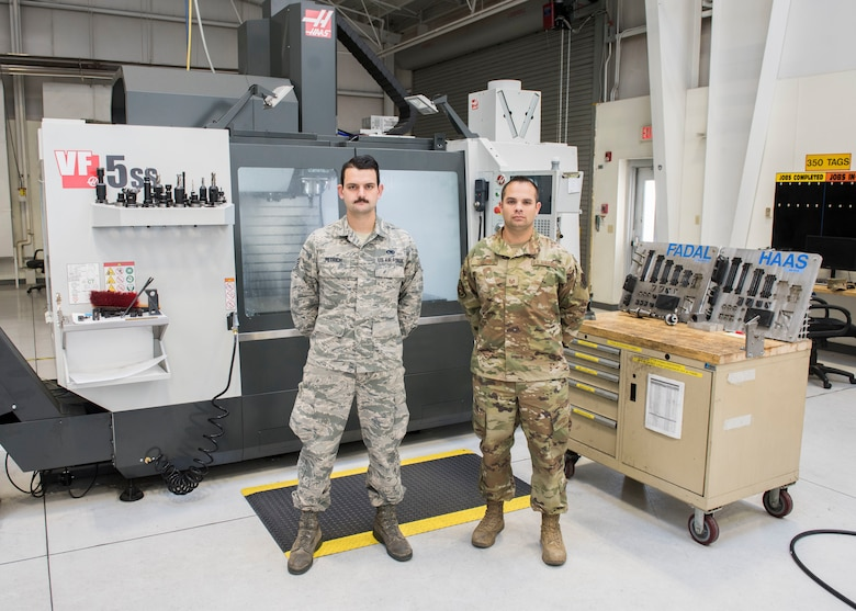 Staff Sgt. David Petrich and Tech. Sgt. Kevin Collins, 366th Maintenance Squadron, metal fabrication mechanics, pose for a photo Oct. 1, 2019, at Mountain Home Air Force Base, Idaho. Collins and Petrich cunstructed a spar repair item used to mend the leading edge wing of an F-15E Strike Eagle. (U.S. Air Force photo by Senior Airman Tyrell Hall)