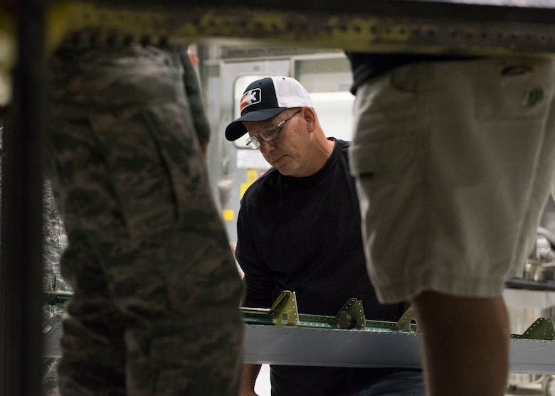 John Swoveland, 402nd Commodities Maintenance Group, aircraft structural mechanic, prepares to attach the leading edge wing of an F-15E Strike Eagle, Oct. 4, 2019, at Mountain Home Air Force Base, Idaho. The leading edge was removed in order to conduct a spar repair on the aircraft. (U.S. Air Force photo by Senior Airman Tyrell Hall)