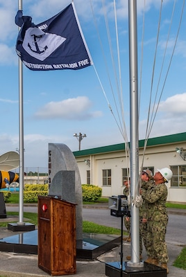 Seabees assigned to Naval Mobile Construction Battalion , raise the battalion colors during the transfer of authority ceremony where NMCB 4 was relieved by NMCB 5.