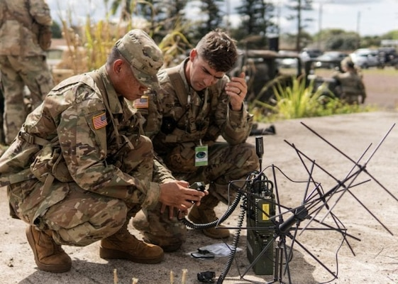 Army soldiers assigned to the 25th Infantry Division, Schofield Barracks, Hawaii, participate in a test of the Navy's Mobile User Objective System.