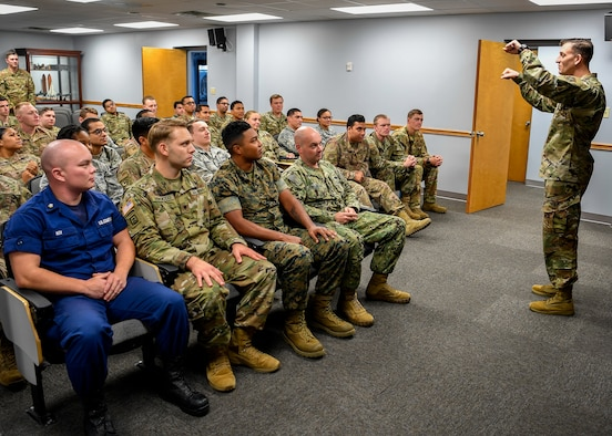 U.S. Air Force Master Sgt. Jeremy Hill, 87th Force Support Squadron Kish Airman Leadership School commandant, converses with Class 19-G before a briefing at Kish ALS on Joint Base McGuire-Dix-Lakehurst, New Jersey, Oct. 11, 2019. The class will graduate on Oct. 17, 2019, after completing the five and a half week course that consisted of 192 hours of curriculum.