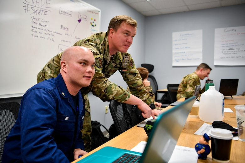 U.S. Coast Guard Petty Officer 3rd Class Brian Moy, USCG Station Atlantic City boatswain's mate, listens to a Kish Airman Leadership School instructor Oct. 7, 2019, at Kish ALS on Joint Base McGuire-Dix-Lakehurst, New Jersey. During ALS, individuals learn problem solving techniques and how to become leaders to junior service members.