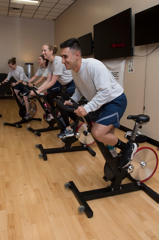 Airmen assigned to Whiteman Air Force Base, Missouri, participate in a cycling class at the Whiteman AFB fitness center on October 10, 2019. The class served as part of the Health and Readiness Optimization (HeRO) strategy, an initiative newly adopted by the Air Force to address targets for health improvements in areas such as physical activity, nutrition, sleep and nicotine cessation. (U.S. Air Force photo by Staff Sgt. Kayla White)