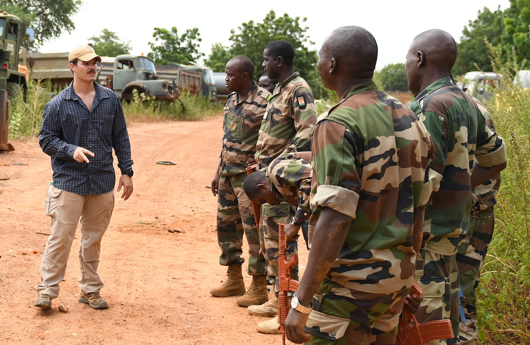 U.S. Air Force Senior Airman Caleb Love, 768th Expeditionary Air Base Squadron Explosive Ordnance Disposal team member, teaches members of the Forces Armées Nigeriennes (Nigerien Armed Forces) Genie Unit how to locate an improvised explosive device during an IED Awareness Course in Niamey, Niger, Oct. 11, 2019. During this week-long course, the FAN learned how to locate and react to an IED, how set up a cordon and the procedures to clear the area. (U.S. Air Force photo by Staff Sgt. Alex Fox Echols III)
