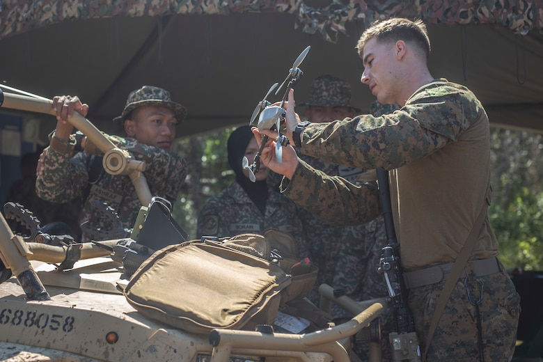 U.S. Marine shows members of the Malaysian Armed Forces a remote controlled drone