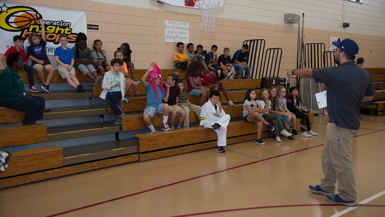 Charles Poliseno, Hillsborough County 4-H youth development extension agent answers questions from MacDill's Youth Center members, Oct. 9, 2019, at MacDill Air Force Base, Fla. The MacDill Youth Center and 4-H team members with Hillsborough County hosted a 4-H National Youth Science Day to introduce MacDill's youth to computer science and programming. (U.S. Air Force photo by Airman 1st Class Shannon Bowman)