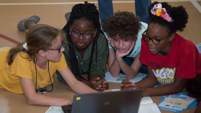 MacDill Youth Center members work on a computer science program during the 4-H National Youth Science Day, Oct. 9, 2019, at MacDill Air Force Base, Fla.  The MacDill Youth Center and 4-H team members with Hillsborough County hosted a 4-H National Youth Science Day to introduce MacDill's youth to computer science and programming. (U.S. Air Force photo by Airman 1st Class Shannon Bowman)