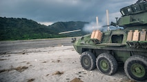A light armored vehicle fires its main gun during a live shoot