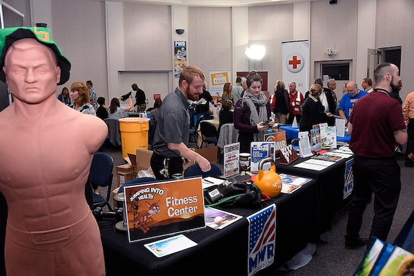 Battle Creek Morale, Welfare and Recreation personnel prepare their exhibit booths at the start of the Occupational Health Unit's annual Health Fair.