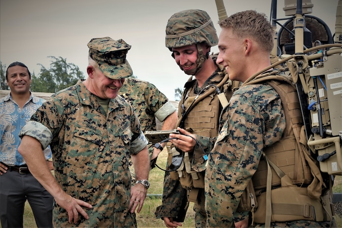 U.S. Marines with Charlie Company, 1st Battalion, 3rd Marine Regiment, show Brig. Gen. Robert Sofge, Deputy Commander, Marine Forces Pacific, a Marine Air-Ground Task Force Common Handheld during the Island Marauder Exercise on Marine Corps Base Hawaii, Kaneohe Bay, Sept. 25, 2019. Sofge was one of the Marine Corps stakeholders attending the event. The Island Marauder exercise is a training event during which Marines conducted different scenarios while testing new technology on the battlefield. (U.S. Marine Corps photo by Ashley Calingo)