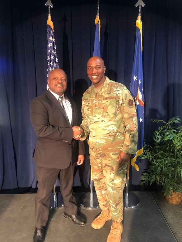 Chief Master Sgt. of the Air Force Kaleth O. Wright shakes hands with Tommy Mcinnis, 61st Air Base Group Equal Opportunity director, Los Angeles Air Force Base, Calif., Sept. 26, 2019. While visiting Los Angeles AFB, he met with Airmen, received Space and Missile Systems Center mission area briefings, and had an opportunity to view the unique characteristic of SMC and the capabilities that the total force offers to accomplish the mission.