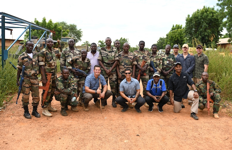U.S. Air Force Airmen assigned to the 768th Expeditionary Air Base Squadron and members of the Forces Armées Nigeriennes (Nigerien Armed Forces) pose for a photo during an Improvised Explosive Device Awareness Course for the in Niamey, Niger, Oct. 11, 2019. The course is part of a curriculum spanning several months designed to improve the FAN's effectiveness and survivability once they deploy to combat the violent extremist organizations in West Africa. (U.S. Air Force photo by Staff Sgt. Alex Fox Echols III)