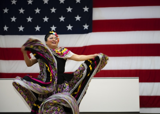 A member of the Ollin Yoliztli Mexican Folklore Dance Academy performs a traditional dance during the Hispanic Heritage Month closing ceremony at the Navy Operational Support Center, Oct. 15, 2019, at Luke Air Force Base, Ariz.