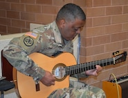 Staff Sgt. Jamie Cruz, Brooke Army Medical Center Warrior Transition Battalion, entertains the audience during a Hispanic Heritage Month celebration in the hospital's Medical Mall Oct. 11, 2019.