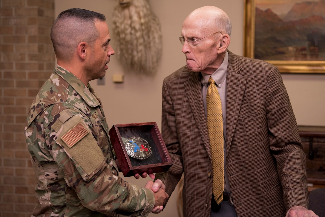 Bill Cauthorn, lifelong honorary commander, receives a custom Laughlin belt buckle from Col. Lee Gentile, 47th Flying Training Wing commander, in Del Rio, Texas, Oct. 15, 2019. Cauthorn is the CEO of The Bank and Trust, and has been a lifelong supporter of Laughlin Air Force Base. (U.S. Air Force photo by Senior Airman Marco A. Gomez)