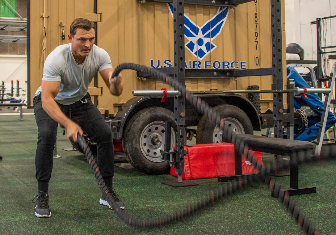 U.S. Air Force Senior Airman Joshua Knutson, 60th Force Support Squadron fitness specialist, performs a battle rope work out in the Nose Dock Gym Oct 11, 2019, at Travis Air Force Base, California. The new gym at Building 844 was facilitated through existing base funds, equipment donations and volunteer work by the 60th Mission Support Group. (U.S. Air Force photo by Heide Couch