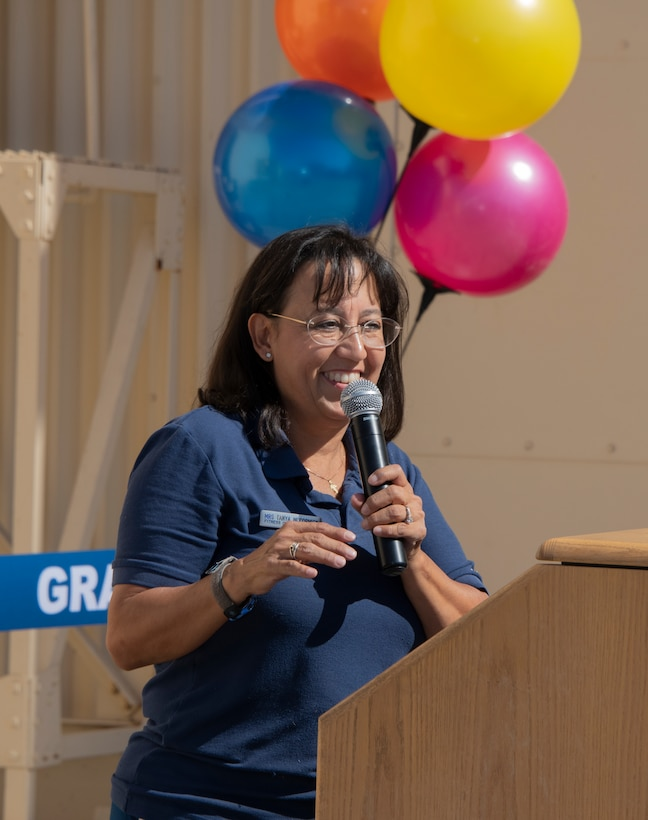 Tanya McCormick, 60th Force Support Squadron fitness and sports center manager, delivers her remarks during the ribbon cutting ceremony of the Nose Dock Gym Oct. 15, 2019, at Travis Air Force Base, California. The new gym at Building 844 was facilitated through existing base funds, equipment donations and volunteer work by the 60th Mission Support Group. (U.S. Air Force photo by Heide Couch)