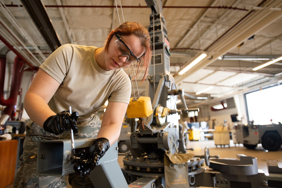 Airman 1st Class Morgan McClurg, 388th Aerospace Ground Equipment flight performs maintenance on a hoist at Hill Air Force Base, Utah, Oct. 4, 2019. Unit Airmen maintain over 600 pieces of equipment that support the mission of crew chiefs, avionics, weapons and ammo troops. (U.S. Air Force photo by R. Nial Bradshaw)