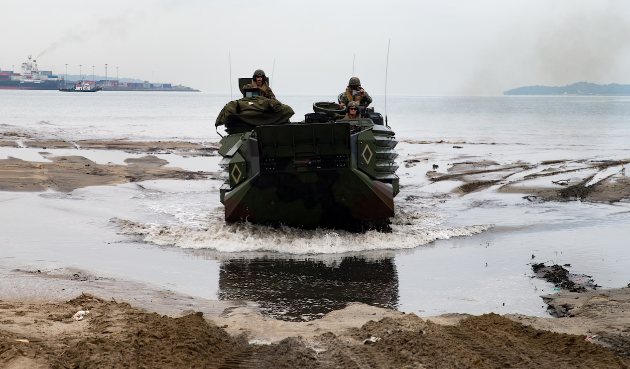 U.S. Marines with Assault Amphibious Vehicle Platoon, Echo Company, Battalion Landing Team 2nd Battalion, 5th Marines, 31st Marine Expeditionary Unit and the Philippine Marine Corps land on the beach in assault amphibious vehicles during KAMANDAG 2 in Subic Bay, Philippines, Oct. 3, 2018. KAMANDAG helps maintain a high level of readiness and enhances bilateral military-to-military relations and capabilities.