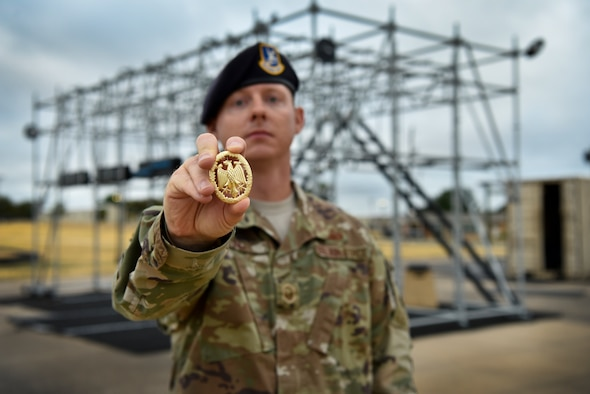 "Master Sgt. Christopher Long, 47th Security Forces Squadron logistics and resources superintendent, holds a German Armed Forces Badge for Military Proficiency at Laughlin Air Force Base, Texas, Oct. 10, 2019. ""This was a great opportunity for our defenders to broaden their horizon and participate in activities outside their scope and challenge their abilities,"" said Long. (U.S. Air Force photo by Senior Airman Marco A. Gomez)"