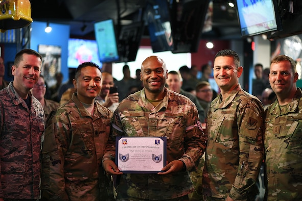 Staff Sgt. Danny D. Wilson, 319th Communications Squadron Information Technology Asset Management Noncommissioned Officer in charge, poses with 319th Reconnaissance Wing and 319th CS leadership for a photo during Wilson's Stripes for Exceptional Performers promotion announcement Oct. 4, 2019 on Grand Forks Air Force Base, North Dakota. STEP promotion from staff sergeant to technical sergeant is a prestigious promotion for exceptional airmen. (U.S. Air Force photo by Senior Airman Elijaih Tiggs)