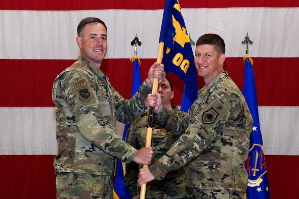 Col. Thomas Falzarano, 21st Space Wing Commander, passes the guidon to Col. John Thien, 721st Operations Group commander, during a ceremony activating the 721st OG Oct. 10, 2019 at Peterson Air Force Base, Colorado. The 721st OG will be singularly focused on securing the electromagnetic spectrum for national security space operations. (U.S. Air Force photo by Craig Denton)