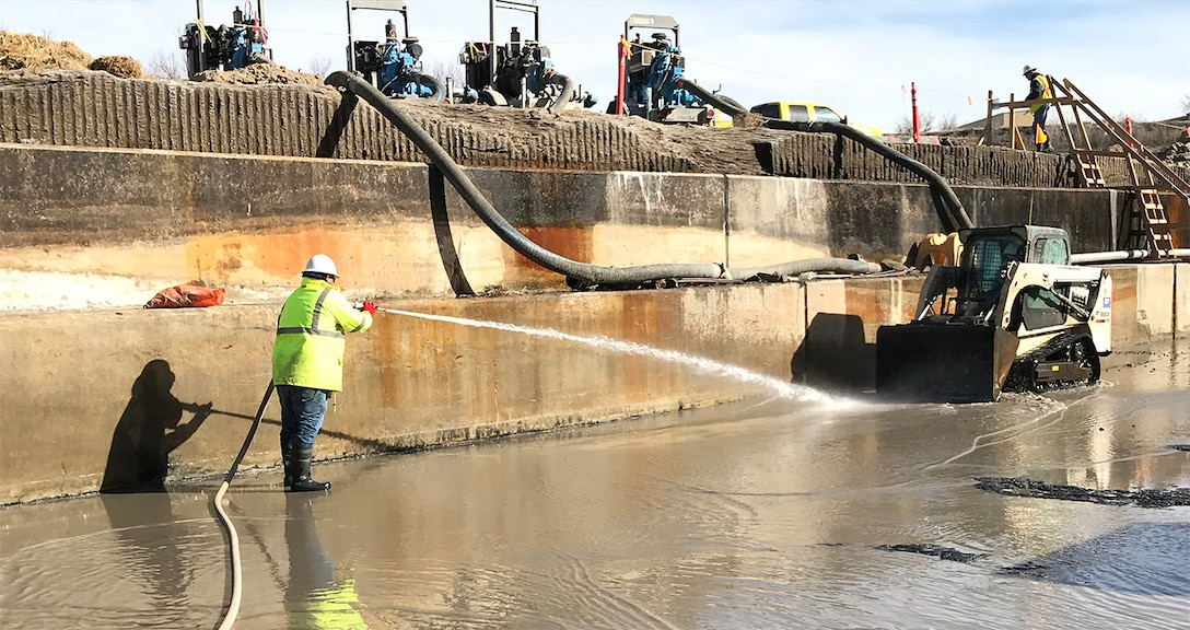 JOHN MARTIN RESERVOIR, Colo. – A worker with McMillen LLC cleans sediment from the stilling basin floor, Feb. 12, 2019. A $4.8 million contract for dewatering and sediment removal in the stilling basin area was awarded to McMillen LLC dba McMillen Jacobs Associates, Sept. 19, 2018.