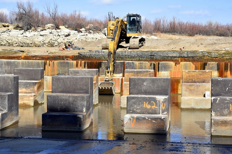 JOHN MARTIN RESERVOIR, Colo. – The baffle blocks in the reservoir's stilling basin are seen in this photo taken March 25, 2019. In the background, the contractor uses an excavator to remove equipment from the stilling basin.