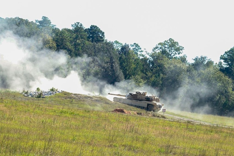 A tank moves up a hill.