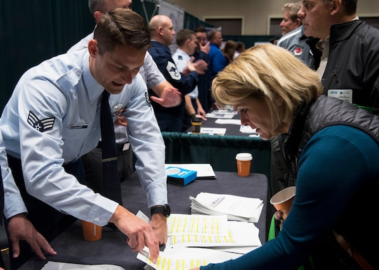 U.S. Air Force Senior Airman Zach Slamon, 92nd Contracting Squadron contracting specialist, speaks with a participant during the 2019 'Meet the Bigs' hosted by Team Fairchild's 92nd CONS and Greater Spokane Incorporated at the Northern Quest Casino in Airway Heights, Washington, Oct. 15, 2019. This third-annual 'Meet the Bigs' event included participation from more than 50 large businesses and federal agencies. (U.S. Air Force photo by Airman 1st Class Lawrence Sena)