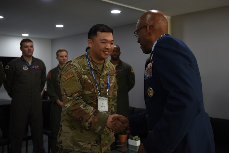 Gen. CQ. Brown, Jr., Pacific Air Forces commander, greets a U.S.Airman during the Seoul International Aerospace and Defense Exhibition 2019 at the Seoul Airport, Republic of Korea, October 16, 2019. Two PACAF Airmen were recognized for their instrumental roles in setting up U.S. participation at Seoul ADEX 2019. (U.S. Air Force photo by Senior Airman Denise M. Jenson)