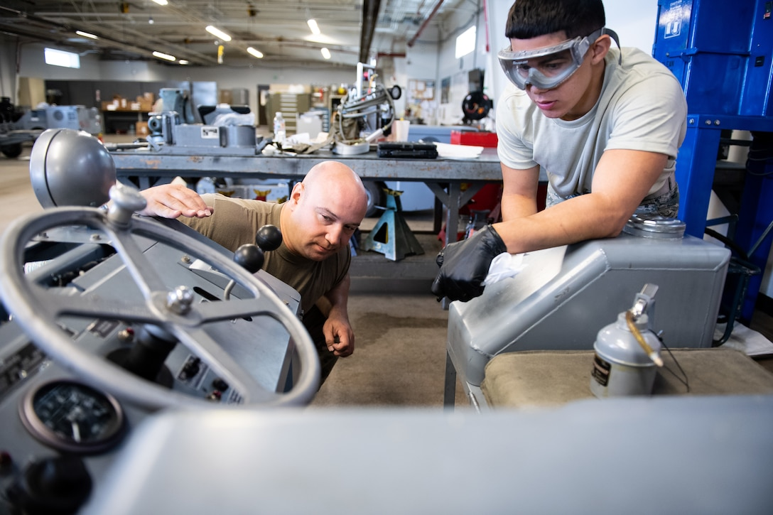 Tech. Sgt. Boris Raykhel, left, and Airman 1st Class Javier Saldana, 388th Aerospace Ground Equipment Flight, inspect a munitions loader during maintenance at Hill Air Force Base, Utah, Oct. 4, 2019. Unit Airmen maintain over 600 pieces of equipment that support the mission of crew chiefs, avionics, weapons and ammo troops. (U.S. Air Force photo by R. Nial Bradshaw)