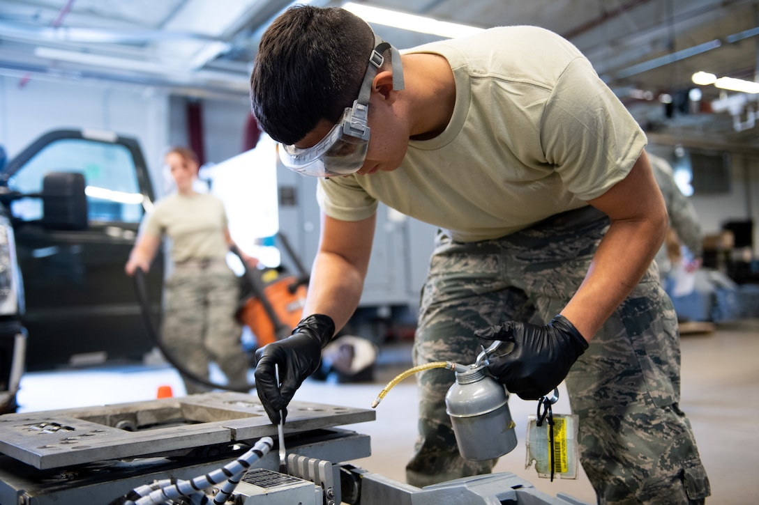 Airman 1st Class Javier Saldana, 388th Aerospace Ground Equipment Flight, performs maintenance on a munitions loader at Hill Air Force Base, Utah, Oct. 4, 2019. Unit Airmen maintain over 600 pieces of equipment that support the mission of crew chiefs, avionics, weapons and ammo troops. (U.S. Air Force photo by R. Nial Bradshaw)