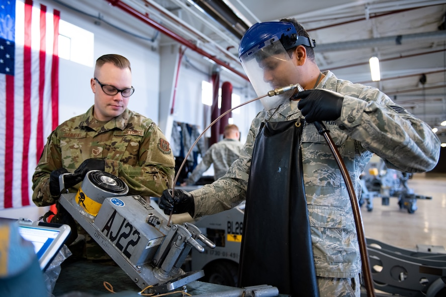 Staff Sgt. Emmanuel May, right, and Staff Sgt Keith Hartfiel, 419th Maintenance Squadron Aerospace Ground Equipment Flight, remove fluid from a piece of equipment during maintenance at Hill Air Force Base, Utah, Oct. 4, 2019. Unit Airmen maintain over 600 pieces of equipment that support the mission of crew chiefs, avionics, weapons and ammo troops. (U.S. Air Force photo by R. Nial Bradshaw)