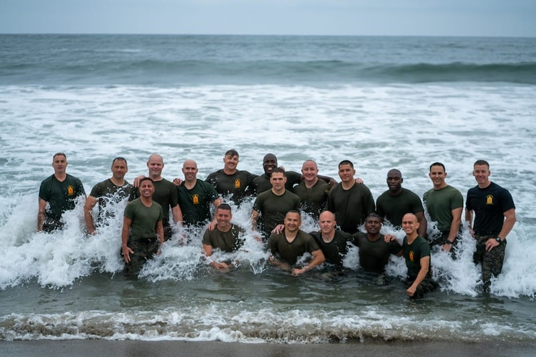 Master Sgt. Paul Willson (kneeling, on left) poses with his group on the San Onofre Beach during the Marine Corps Staff Non-Commissioned Officer Academy at Camp Pendleton, California.