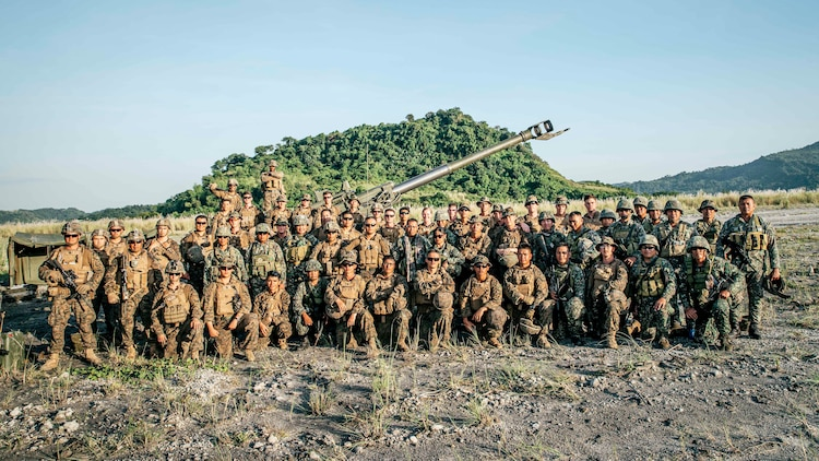 U.S. Marines and Philippine Marines with the 17th Marine Corps Field Artillery Battalion, pose for a group photo