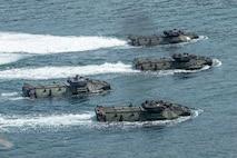 Assault amphibious vehicles participate in an amphibious landing during exercise KAMANDAG 3