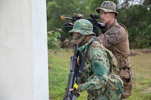 U.S. Marines and soldiers with the Royal Brunei Armed Forces set secuirty