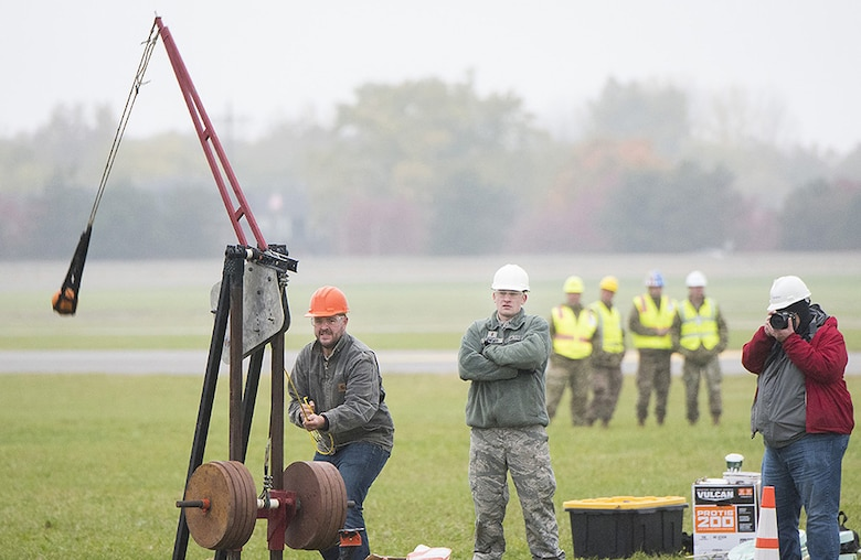 A team readies their machine to hurl a pumpkin into the air, competing for the longest distance in the Air Force Life Cycle Management Center's Pumpkin Chuck competition. Teams compete in three categories, which vary in size of machine, weight of pumpkin, and Human-powered.(Courtesy photo)