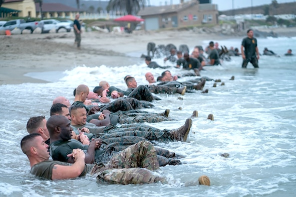 Master Sgt. Paul Willson (left) leads his group in physical training on the San Onofre Beach during the Marine Corps Staff NCO Academy at Camp Pendleton, California.
