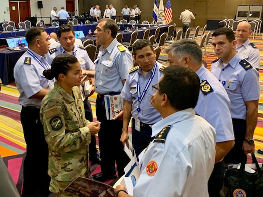 1st Lt. Lorrayne Kealty, 14th Air Support Operations Squadron, Pope Army Air Field, N.C., speaks with Central and South American air force leaders at the Conference of American Air Chiefs in Panama in June 2019. As a Language Enabled Airman Program scholar, Kealty presented at the conference at the encouragement of her squadron commander, Lt. Col. Christopher Sweeny. Conference attendees were pleasantly surprised by Kealty's mastery of their native language, choosing to listen to her in person instead of relying on interpreters speaking through their earpieces. (Courtesy photo)
